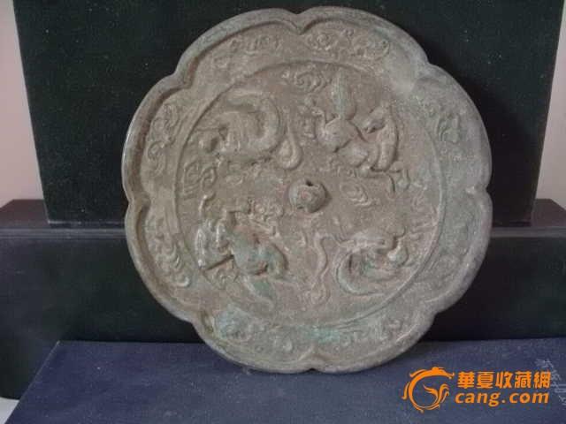 凤鸟走兽纹葵花型铜镜